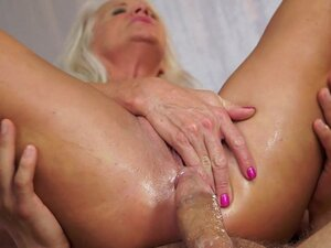 Mature blonde being fucked in her asshole