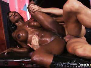 Oily ebony babe gets her mouth filled up with a thick load of cum