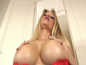Busty milf Nikita in hot red dress has her hands chained and she likes it