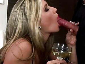 Gorgeous blonde in black sexy lingerie gives a blowjob
