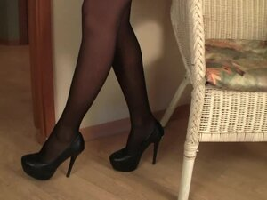 Gorgeous brunette in black pantyhose
