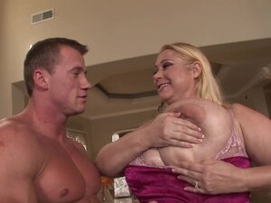Busty blonde gets cum in her wide mouth