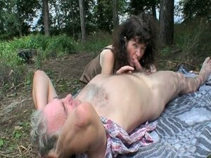 Young brunette joins old couple in the woods for sex