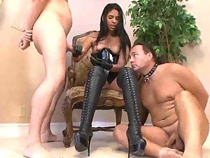 Mistress in gloves masturbates two slaves