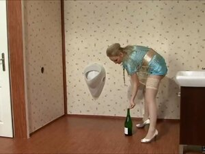 Wow this insane blonde bitch is definitely needing something to fill her cunt. She kicks off the fun by fucking a large champagne bottle and then getting on all fours and finger fucking her tight little cooter. Our cum cannon lets loose with streams of sl
