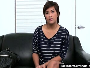 Shorthaired asian with big tits giving a blowjob and gets fucked at audition.