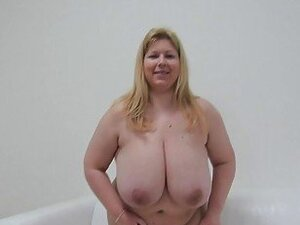 Big beautiful woman strips and reveals her huge bosom