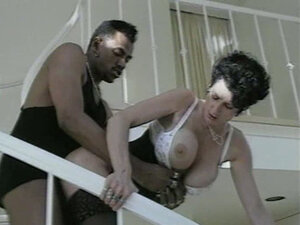 Brunette busty whore wife is fucked by her black lover on the stairs. Deep cock penetration
