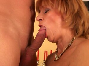 Milf Lady swallows long hard dick of her young bf