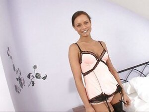 Tanned bruentte in sexy lingerie and stockings swallows cum