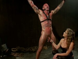 Helpless dude in tattoos is tortured by horny bitch