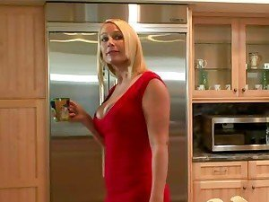 Mellanie Monroe sucks and rides a hard prick in the kitchen