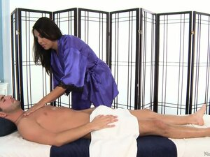 Busty masseuse gives her hung client a wank to wrap things up