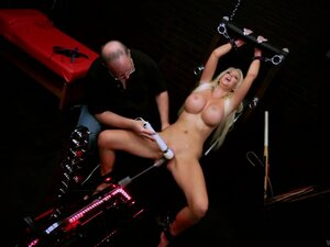 Busty blonde babe is overcome with vibrator and a fuck machine