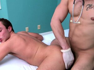 The doctor continues to probe his asshole, pushing in balls deep