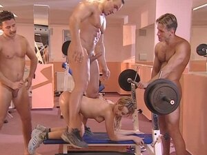 Horny little blonde gets ganged on in the gym