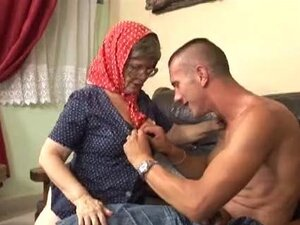 mature amazing granny hungry young man sex on a sofa