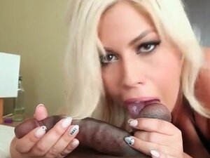 Bridgette B puts her mouth to work on black balls