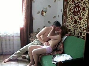 Amateur couple fucking on a sofa