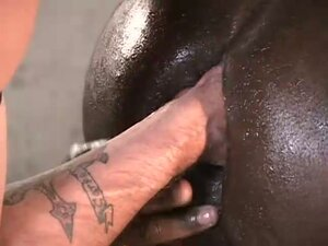 A fist deep in the black ass-hole