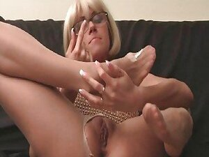 Long legged blonde in pantyhose and high heels stripping and teasing