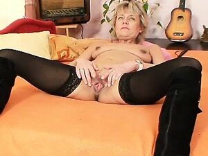 Older mature woman dresses black domina clothes and gets