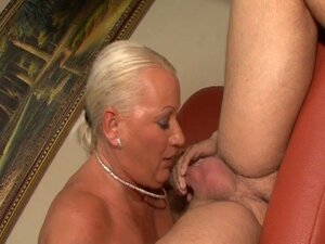Blonde grandma fucked by a hard young cock in nail on the coach
