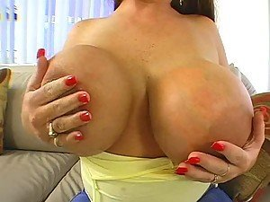 Watch this video with redhead slut who's got giant boobs