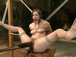 Tied Up Brunette Gets Her Pussy Toyed and Her Ass Fucked By Machine