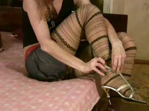 Girl masturbates in pattern pantyhose