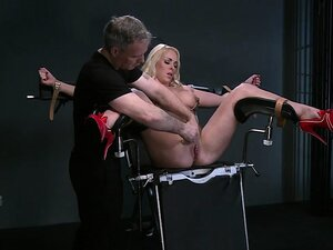 Busty blonde babe strapped in gyni chair vibed and squirts