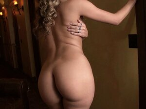 Blonde MILF with a very fine ass poses and works her fingers and pussy toy