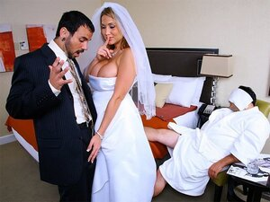 A cheeky bride that's just married gets busy with the best man as the groom sleeps