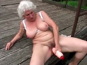 Huge dildo sex outdoors with curvy grandma