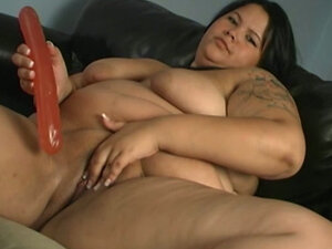 Young BBW brunette hoe watches porn and plays with dildo