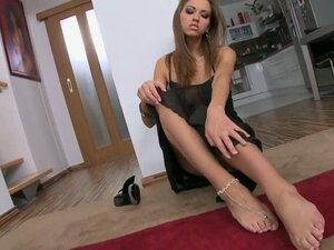 Elegant angel plays with the dildo with her feet