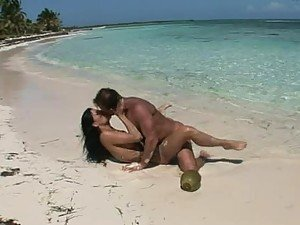 Hot couple is banging on the beach in white sand