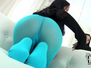 Brunette babe in blue tights poses, shows hot ass and licks her feet