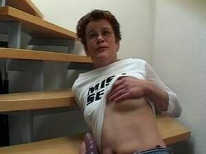 Granny masturbating her pussy on the stairs