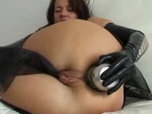 Girl in gloves puts beer can in her anal hole