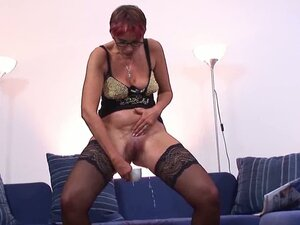 Dirty milf in a black laced pantyhose pissing on her teacup