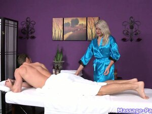 Watch a gorgeous blondie massage a big cock with her lips and tongue