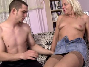 Mature blonde is riding on the young dick