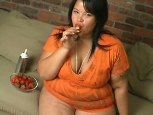 Naughty BBW whore smears her boobs with whipped cream and strawberry