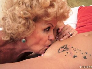 Nasty granny and an even nastier young blond lezzie come together for a porn shoot