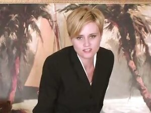 Short haired natural blonde Mindy climbs onto her desk and starts inserting random office supplies into her shaved pussy