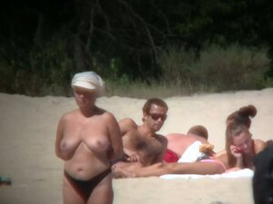 Huge boobed sexy ladies lie on the beach and relaxing