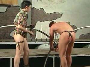 Male slave in thong gets his naked ass