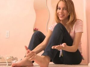 Teen Maya in pink swimsuit appears in foot fetish video