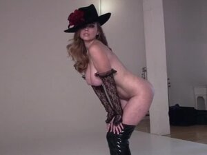 Candace Rae the horny babe in high boots poses at the photo shoot